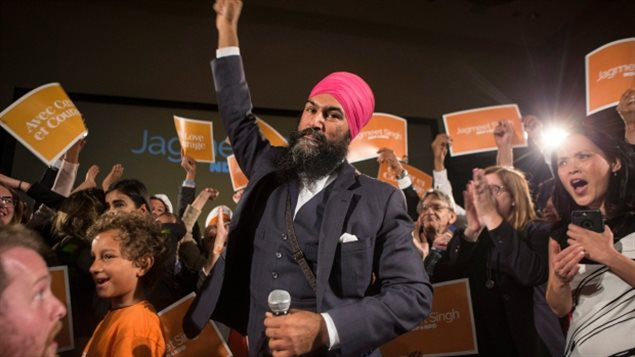 Jagmeet Singh celebrates with supporters after winning the first ballot in the NDP leadership race to be elected the leader of the federal New Democrats, becoming the first member of a visible minority to lead a major federal party in Canada.