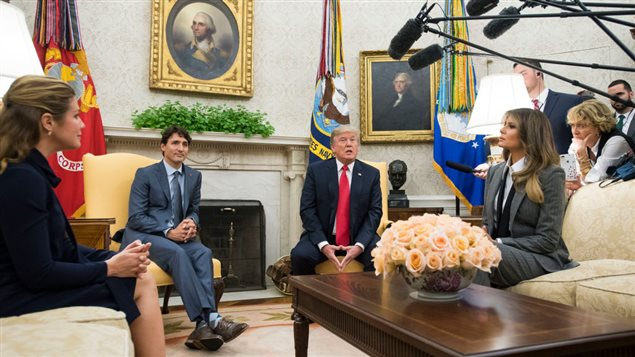 U.S. President Donald Trump (2nd-R) and first lady Melania Trump (R) meet with Canadian Prime Minister Justin Trudeau (2nd-L) and his wife Gregoire Trudeau in the Oval Office at the White House on October 11, 2017 in Washington, DC.