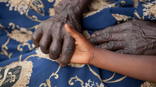 In raising their grandchildren, many African grandmothers faced poverty, stigma as well as their own and the children's grief.