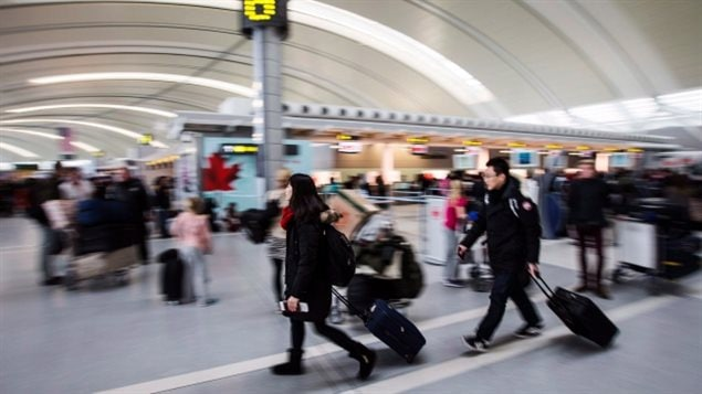 Passengers in the Toronto Pearson Airport in 2013. Inspection agents have changed policy on calling police when marijuana is found.