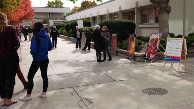 Demonstrators gathered outside the Okanagan College Kelowna campus with large, graphic photos of aborted fetuses.  Ontario will ban such activities within 50 metres of abortion clinics
