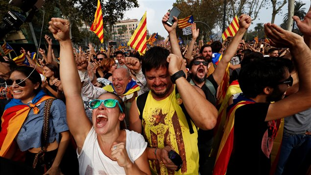 People celebrate after the Catalan regional parliament declares the independence from Spain in Barcelona.
