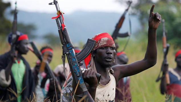 SPLA-IO (SPLA-In Opposition) rebels hold up guns in Yondu, the day before an assault on government SPLA (Sudan People's Liberation Army) soldiers in the town of Kaya, on the border with Uganda, South Sudan, August 25, 2017.