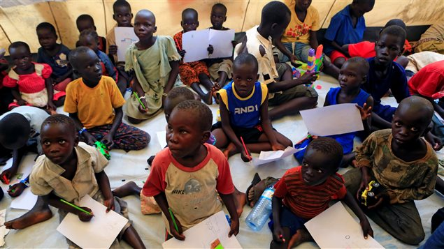 Unaccompanied minors who fled civil war in South Sudan draw during a vist of United Nations Secretary General at Imvepi settlement camp in northern Uganda Antonio Guterres June 22, 2017.