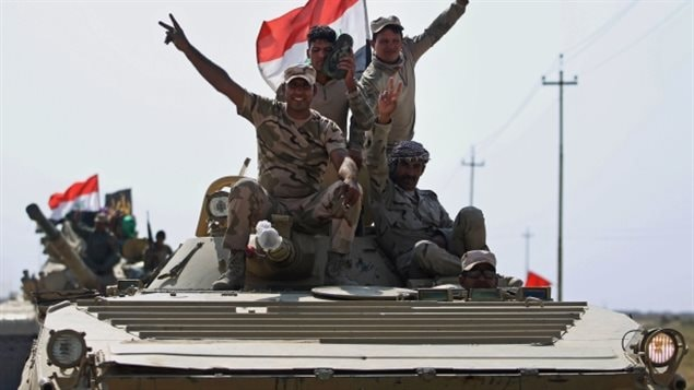 Iraqi forces drive towards Kurdish Peshmerga positions on October 15, 2017, on the southern outskirts of Kirkuk.which the Kurds occupied after chasing out Daesh. A temporary halt to Canadian military assistance will remain in effect until it's clear the fighting between pro-independence Kurds and the central government in Baghdad is over.