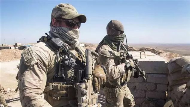 Canadian special forces look over a Kurdish Peshmerga observation post, Monday, February 20, 2017 in northern Iraq. Canadians have been advising and assiting Kurish and Iraqi forces against Daesh, but are suspending operations due to tensions bewtween the two former allies