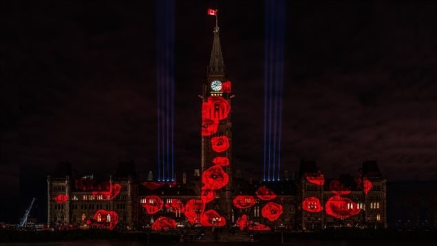 The *poppy drop* 117,000 images of poppies slowly cascade down Canada's Parliament buildings, each one representin a Canadian solider who paid the ultimated sarifice in war and conflicts since the beginning of the First World War.