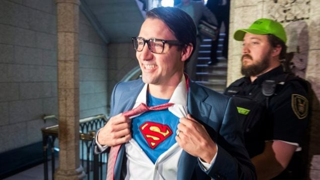 Prime Minister Justin Trudeau shows off his costume as Clark Kent, alter ego of comic book superhero Superman, as he walks through the House of Commons, in Ottawa on Tuesday.