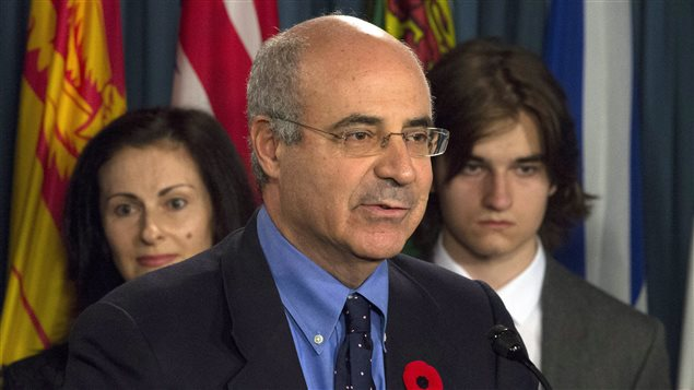 Sergei Magnitsky's son Nikita Magnitsky and his mother, Natalia look on as Bill Browder responds to a question during a news conference on Parliament Hill in Ottawa, Wednesday November 1, 2017.
