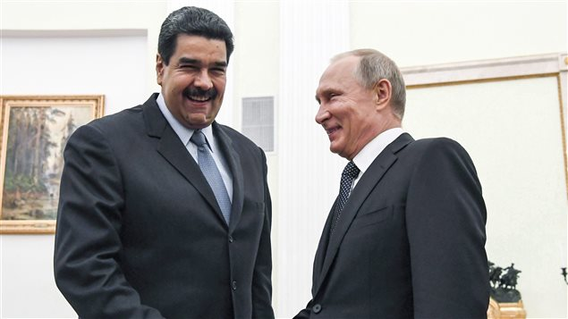 Russian President Vladimir Putin, right, shakes hands with Venezuela's President Nicolas Maduro during their meeting at the Kremlin in Moscow, Russia, on October 4, 2017. Canada is taking aim at corruption and rights abuses in Russia, Venezuela and South Sudan by imposing targeted sanctions on 52 individuals, including Venezuelan President Nicolas Maduro.