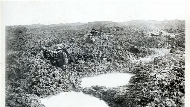 Troops of the Canadian 16th Machine Gun Company hold the line in atrocious conditions on the Passchendaele front in late October or early November, 1917 The machine-gunner closest to the camera is Private Reginald Le Brun, the only one in the photo to survive.