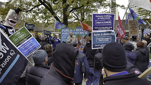OPSEU rally on Sunday in Toronto near the site of a conference rof business owners to provide information on P3 deals with government
