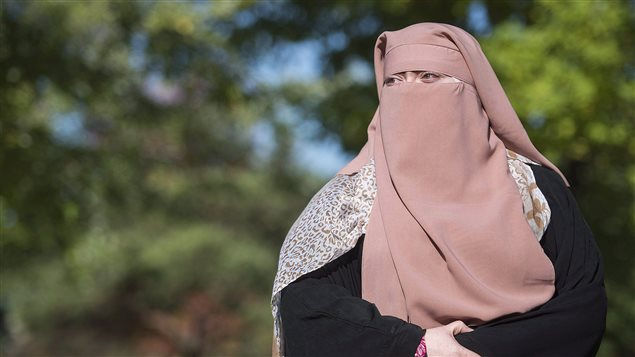 Marie-Michelle Lacoste, a Muslim convert who wears the face-covering veil and goes by the name Warda Naili, is challenging the constitutionality of a controversial Quebec legislation that requires her to remove her niqab while giving or receiving public services.