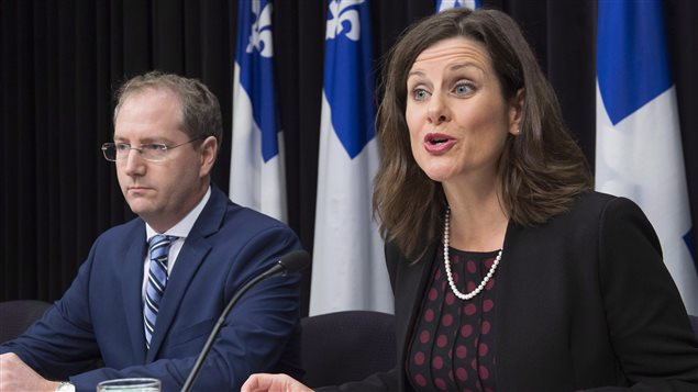 Quebec Justice Minister Stephanie Vallee provides further details about how the government's controversial Bill 62 will be implemented at the legislature, as Justice Minister Yan Paquette, left, looks on in Quebec City Tuesday, October 24, 2017. The law bans people from giving or receiving public services if their face is covered.