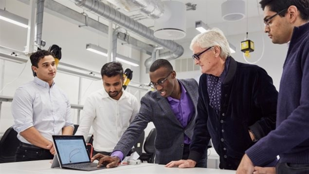 The sKan team members, left to right, Prateek Mathur, Shivad Bhavsa, Rotimi Fadiya, and, far right, Michael Takla meet with inventor James Dyson, who is second from right, after winning this year's James Dyson Award.