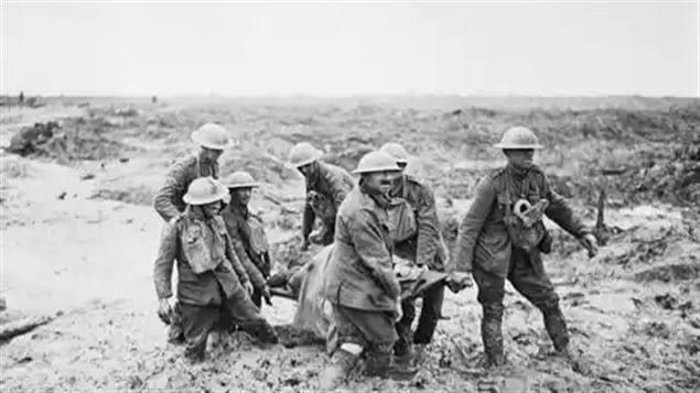 A strecther party struggles through knee deep mud at Passchendaele