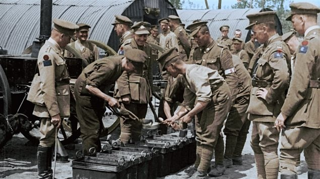Meal time. The government sent cameramen along with the troops to capture films of soldiers lives to be shown to the public...but not actual battle scenes. films were restored and colourized for this new compilation presentation, and in a unique blend of sketches and film and narrative.