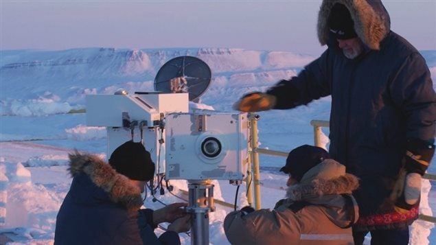 Instruments travel to PEARL for satellite validation campaigns such as that held in support of Canada's Atmospheric Chemistry Experiment (ACE) every polar sunrise from 2004 to this one in 2008, and beyond. Here the ground-based version of the ACE MAESTRO instrument is installed on a sun tracker under the supervision of Environment Canada's Tom McElroy, MAESTRO PI with the able assistance of Clive Midwinter and Mareile Wolff, both from the University of Toronto. (Pierre Fogal/CANDAC)