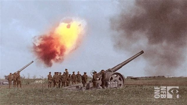 Two huge artillery pieces at the moment of firing. From restored and colourized film for the new production *Return to Vimy*