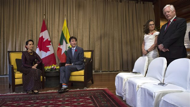 Canadian Prime Minister Justin Trudeau acknowledges Bob Rae, right, as Foreign Affairs Minister Chrystia Freeland and Myanmar leader Aung San Suu Kyi, left, look on before a bilateral meeting at the APEC Summit in Da Nang, Vietnam Friday November 10, 2017.