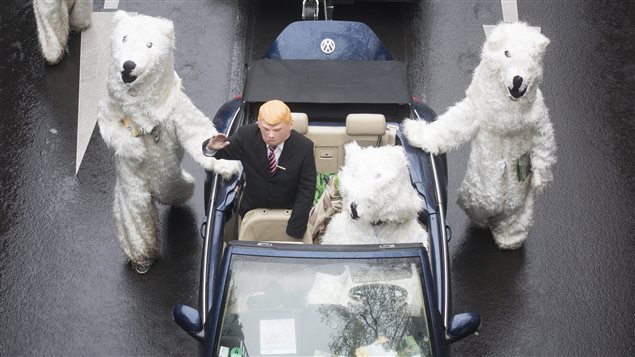 Demonstrators dressed up as U.S. President Donald Trump and polar bears protest climate change during the climate conference in Bonn, Germany on Nov. 11, 2017.