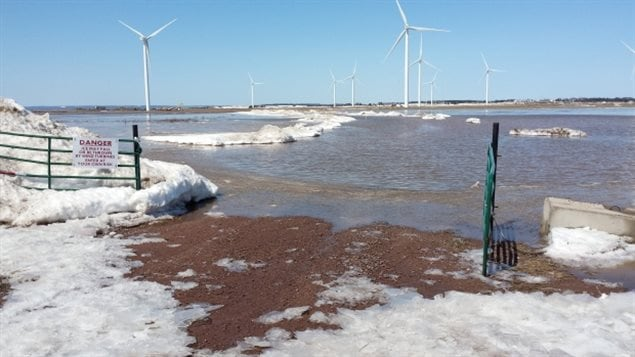Water is beginning to breach the dikes near the Amherst Community Wind Farm.