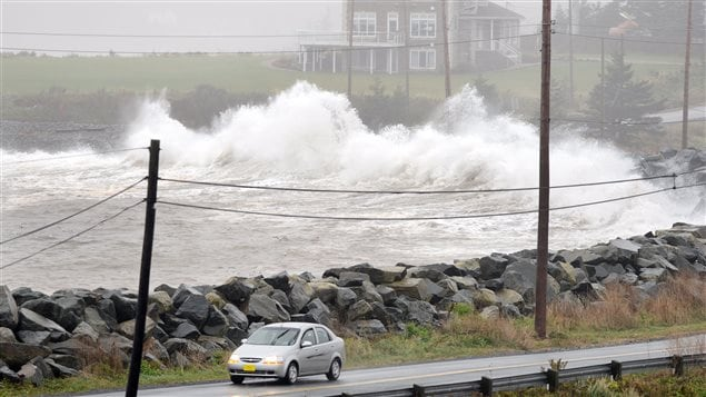 Waves hit the shore in Cow Bay, N.S. near Halifax on Tuesday, Oct. 30, 2012.