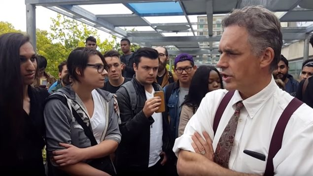 2016: Award winning University of Toronto psychology professor Jordan Peterson attempts to explain his position to a crowd oustide the university before being disrupted by an unruly group of protesters.
