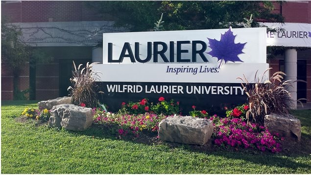 Picture of the Wilfrid Laurier University landmark signage at the southeast corner of the Waterloo campus. The respected university is embroiled in a free speech issue for castigating a teaching assistant over a tutorial lesson in communication and language after she showed a brief clip of a publicly broadcast debate on a respected TV Ontario show.