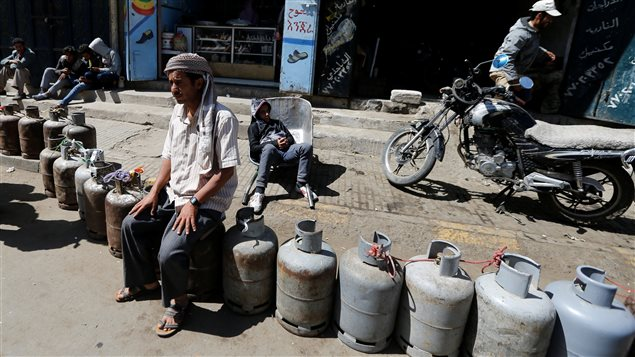 Cooking gas cylinders are lined up outside a gas station amid supply shortage in Sanaa, Yemen November 7, 2017.
