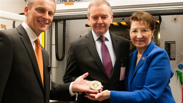 Senators David Wells, Serge Joyal and Betty Unger hold up the first test Senate of Canada Sesquicentennial Medal at the Royal Canadian Mint on June 7, 2017.