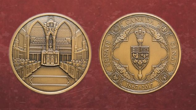 The medals are made of an alloy of bronze, copper,and zinc. The front of the medal features the Senate's badge and the reverse side depicts the Senate Chamber. A space is provided to inscribe the name of the recipient