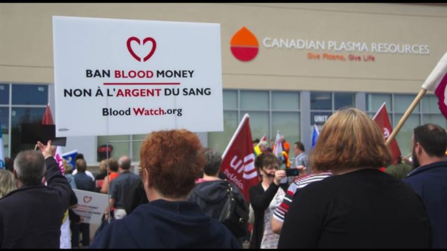 Protesters gathered in front of a paid-plasma clinic in Moncton, New Brunswick on May 30, 2017.