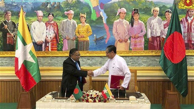 In this image provided by Myanmar's Ministry of Information, Myanmar's Union Minister for the Office of the State Counsellor Kyaw Tint Swe, right, shakes hand with Bangladeshi Foreign Minister Abdul Hassan Mahmud Ali after signing the Arrangement on Return of Displaced Persons from Rakhine State in Naypyitaw, Myanmar, Thursday, Nov. 23, 2017.