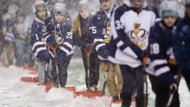 It's a Canadian thing. Fans shovel snow from the field before the match at Lansdowne Park's TD Place before the 105th Grey Cup on Sunday, Nov. 26, 2017 in Ottawa.