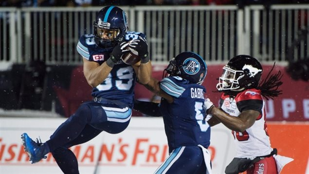 After trailing most of the game, in the final seconds, Toronto defensive back Matt Black, left, intercepts a Calgary pass in the Argo endzone to seal the Argonauts' Grey Cup victory and dash the Stamps desperate hopes of last moment win.