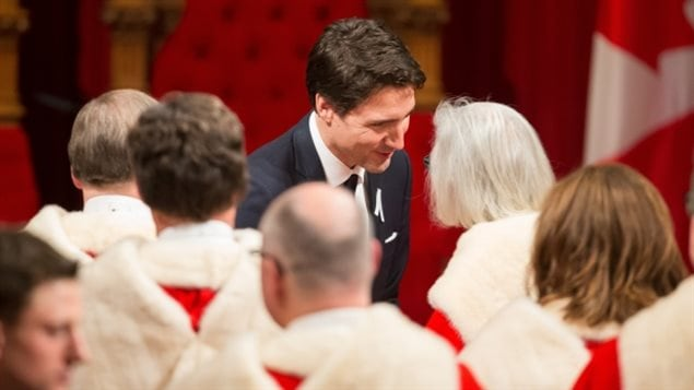 Prime Minister Justin Trudeau speaks with Chief Justice Beverly McLachlin and other justices of the Supreme Court in 2015.