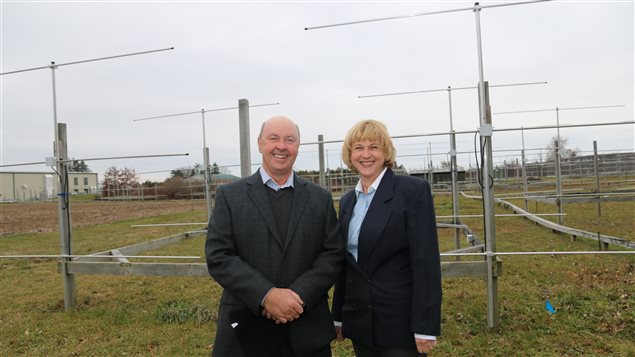 Prof. Wayne and Anna Hocking stand before VHF windprofiler radars they say can help better predict tornadoes.