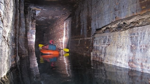 An inflatable canoe was brought down to further explore the new passage.