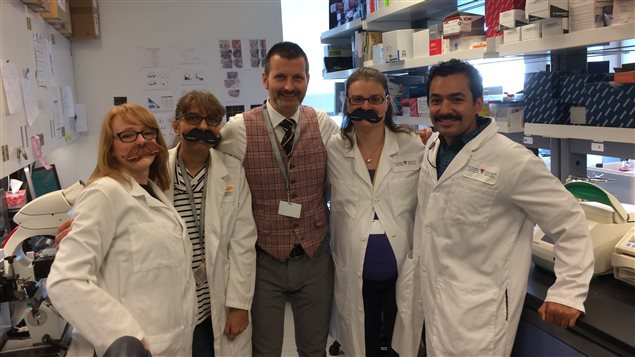 Professor Thomson with members of his lab sporting moustaches as part of the annual *Movember* campaign. Movember helped fund the research
