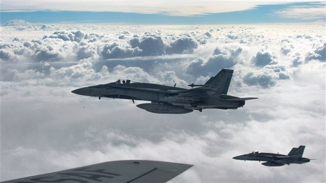 Royal Canadian Air Force CF-18 Hornets depart after refueling with a KC-135 Stratotanker assigned to the 340th Expeditionary Air Refueling Squadron, October 30, 2014, over Iraq. Buying surplus Austalian F-18s will save the government money in parts and training as well as huge purchase cost difference over the now