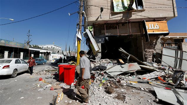 A man walks past a damaged restaurant on a street where Houthis have recently clashed with forces loyal to slain Yemeni former president Ali Abdullah Saleh in Sanaa, Yemen December 6, 2017.
