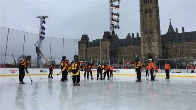 A broomball team takes to the ice as part of the official opening of the rink earlier today.