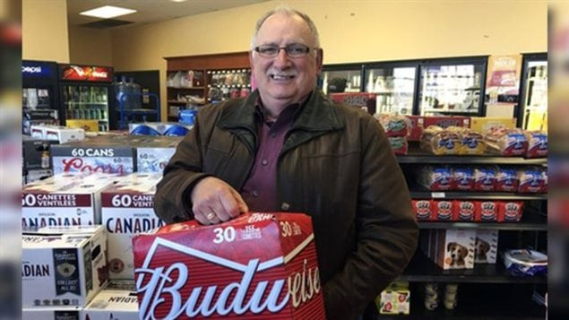 Gerard Comeau buying beer in Quebec after his 2016 court win in New Brunswick court. The province has appealed to the Supreme Court of Canada