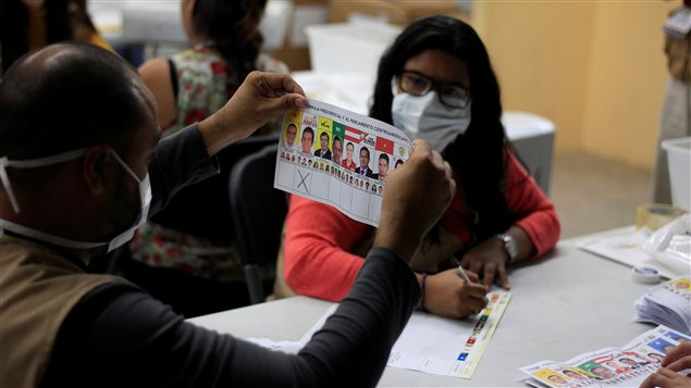 Scrutineers re-count ballots of the general election during a partial re-count in presidential vote, at a vote counting center in Tegucigalpa, Honduras December 7, 2017.