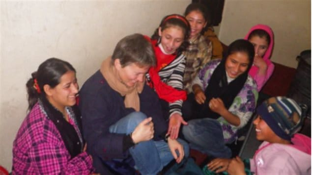 In an undated photo, Deborah Ellis talks to girls at an orphanage funded by Canadian Women for Women in Afghanistan.
