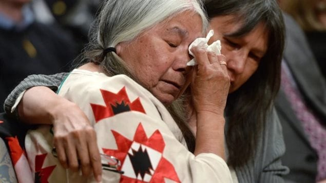 Residential school survivor Lorna Standingready is comforted by a fellow survivor during the closing ceremony of the Truth and Reconciliation Commission, at Rideau Hall in Ottawa on June 3, 2015. (Sean Kilpatrick/Canadian Pres