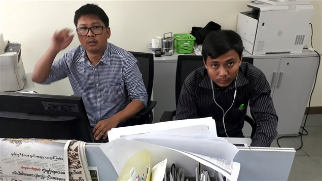 Reuters journalists Wa Lone (L) and Kyaw Soe Oo, who are based in Myanmar, pose for a picture at the Reuters office in Yangon, Myanmar December 11, 2017.