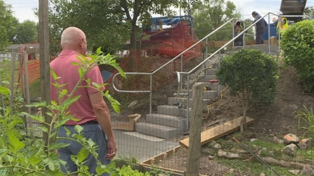 Adi Astl, a 73-year-old retired mechanic, left, who built a homemade staircase for $550 at a steep popular shortcut in a small park, commended the city for quickly addressing the issue with a new set of stairs, which opened in late July