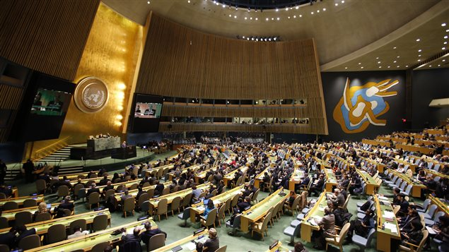 People gather at the General Assembly, prior to a vote, Thursday, Dec. 21, 2017, at United Nations headquarters. President Donald Trump's threat to cut off U.S. funding to countries that oppose his decision to recognize Jerusalem as Israel's capital has raised the stakes in Thursday's U.N. vote and sparked criticism of his tactics, with one Muslim group calling it bullying or blackmail.
